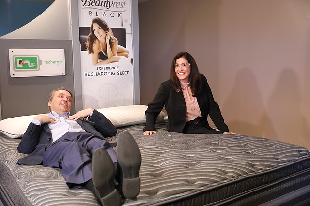Gov. Jeff Colyer and his wife, Ruth, test out mattresses at Serta Simmons Bedding in western Shawnee.