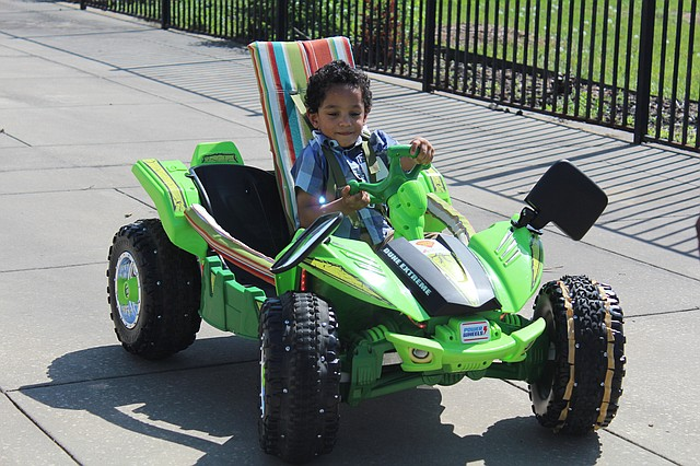 Four-year-old Jerry Guild drives his new modified Power Wheels car at the Geeks Vs. Geeks build event on Sunday afternoon at the Mark One Electric Headquarters in Kansas City, Mo.