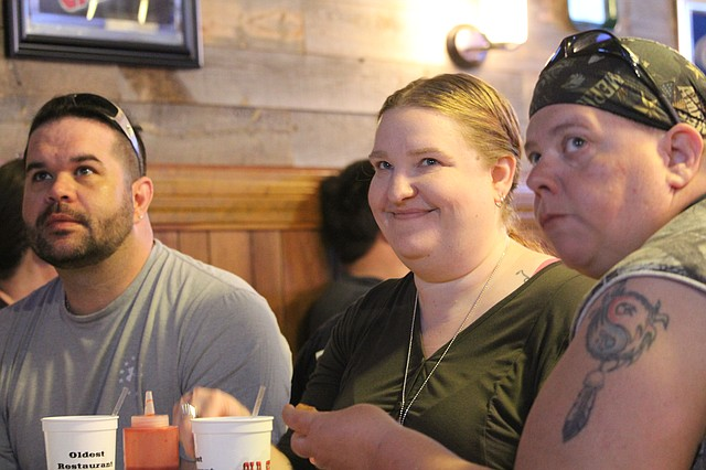 "Shawnee resident and former business owner Becky Bieker, center, watches her first episode of ""The Journey"" during a watch party at Old Shawnee Pizza on May 7."