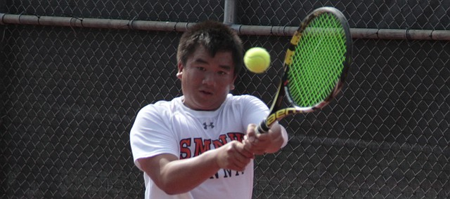 Shawnee Mission Northwest junior Nam Pham hits a backhand return during the semifinals of the Class 6A boys tennis state tournament on Saturday at the Kossover Tennis Center in Topeka.