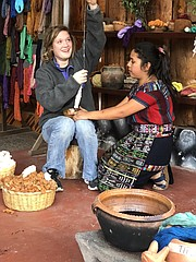 Tonganoxie resident Anna Soetaert spins yarn with help from a local woman in Guatemala.
