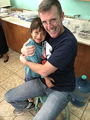 Tonganoxie dentist Grant Ritchey hugs one of his patients during a February tripo to Guatemela where the dentist helped administer discounted dental care to many in the area.