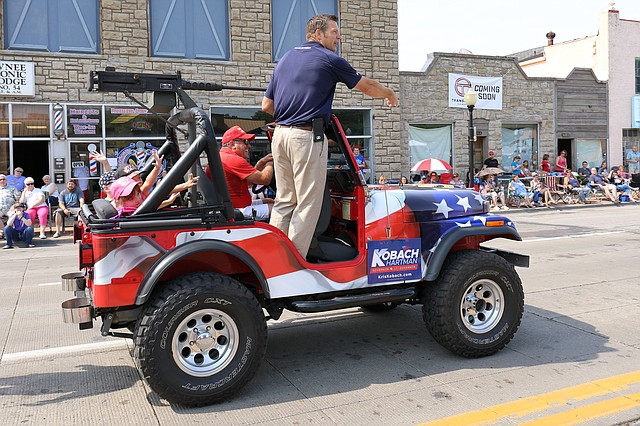 Kansas Secretary of State Kris Kobach rides in the Old Shawnee Days parade on June 2.
