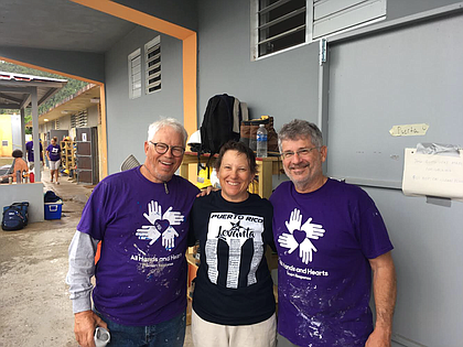 David Williams, left, and Jon Augustine, right, pose with Patricia Wittry, of Garnett, Kan., who is a volunteer they befriended during their two-week service stint in Puerto Rico.
