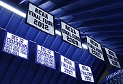 Final Four and Big 12 conference championship banners that commemorate accomplishments of the Kansas men's basketball team hang from the roof of Rory Ramsdell's garage in Shawnee.