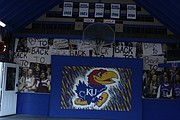 A basketball goal hangs from the back wall of Shawnee resident Rory Ramsdell's garage. The University of Kansas alumnus has turned the garage into a mini Allen Fieldhouse.