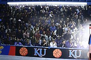 A large plot photo taken by Shawnee resident Rory Ramsdell at a Kansas men's basketball game aligns one of the side walls of his garage, which doubles as a mini Allen Fieldhouse.