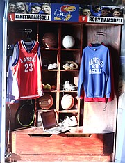 Lockers for Rory and Renetta Ramsdell sit in the corner of a garage, which doubles as a mini Allen Fieldhouse, at their Shawnee residence. The lockers are designed like the ones for the KU basketball players in the Allen Fieldhouse locker room.