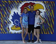 From left, Raegan Ramsdell, Rory Ramsdell and Bailey Ramsdell gather for a photo inside a garage at their Shawnee residence that doubles as a mini Allen Fieldhouse.
