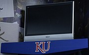 A television sits on a ledge in one of the corners of Shawnee resident Rory Ramsdell's garage, which doubles as a mini Allen Fieldhouse. Ramsdell and his family use the TV to watch KU men's basketball games when the Jayhawks play on the road.