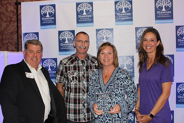 From left to right: Leo Nunnink, chair of the Shawnee Economic Development Council; Mike Unterreiner, Shawnee Downtown Partnership; Dawn Tubbesing, Stag's Creek and Mayor Michelle Distler, pose with the Downtown Revitalization Award for Stag's Creek at the Good Business Awards luncheon at Shawnee Town Hall on Thursday.