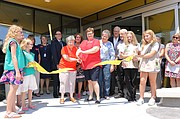 Before doors opened at 1 p.m. Sunday, library officials had a ribbon-cutting ceremony in front of the new building. Boy Scouts and Girl Scouts helped with the festivities. At a reception inside the community meeting room, patrons enjoyed refreshments and listened to a variety of speakers.