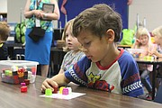 Future Bluejacket-Flint kindergarten student Elias Carlson practices counting at Jump Start for Learning, a program which helps youth prepare for the first day of elementary school.