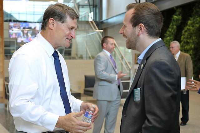 New Shawnee Mission Superintendent Mike Fulton, left, chats with Rep. Tom Cox, right, at an open house on Aug. 6 at the Center for Academic Achievement. Cox, who represents District 17, graduated from Shawnee Mission Northwest High School in 2004.