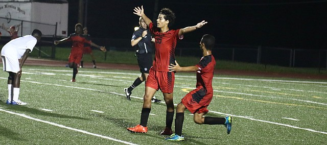 Mahmoud Abu Zareefeh (35) celebrates after scoring the golden goal with 2:53 remaining in double-overtime to guide Shawnee Mission North to a 2-1 win over Leavenworth on Thursday.