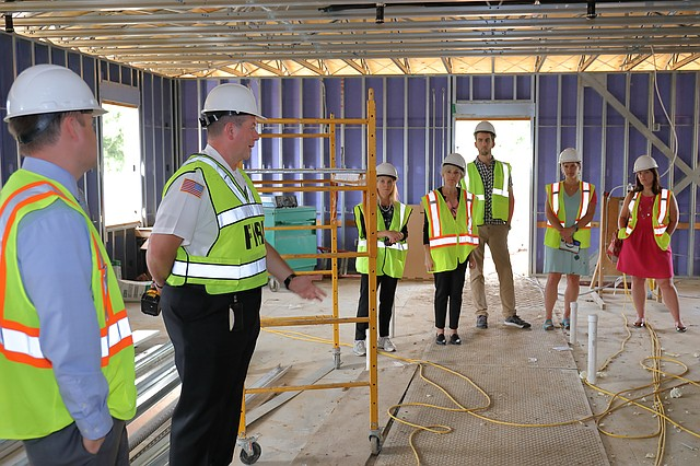 Shawnee Fire Chief John Mattox, second to left, guides council members and city staff on a tour of Fire Station 74, which is under construction in northwestern Shawnee.