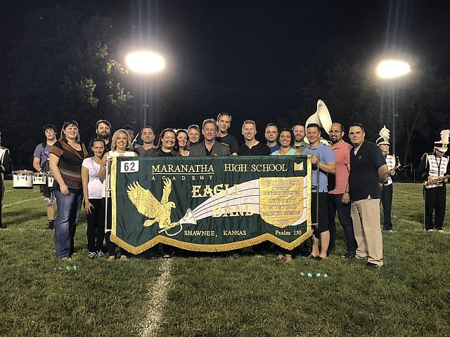 Several former members of the record-breaking 1998 Maranatha Christian Academy high school marching band attended a recognition ceremony on the football field of St. Joseph Catholic School on Friday night. Left to right:  Robyn Thew Thompson,  Angel Berthold Woods, R.J. Stafos, Tara Cohen Titsworth, Chris Ploetz, Erin Conner, Elise Ham Finger, Matt Gordon, Steve Gordon, Tim Andersen, Thomas Rye, Josh Frisbie, Merah Anderson Wright, Lucas Millican, Patrick Gordon, Justin Medford and Kyle Unmack.
