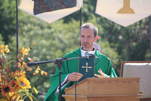 Fr. Scott Wallisch gives his sermon during the 150th celebratory Mass at St. Joseph Catholic Church on Saturday afternoon.