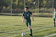 De Soto High School boys soccer senior Jacob Powers (No. 20) dribbles the ball against Turner High School Tuesday night at De Soto High School in De Soto.