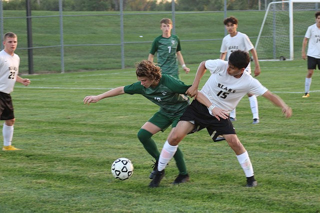 De Soto High School boys soccer junior Trent Mann (No. 10) fights for the ball against Turner High School Tuesday night at De Soto High School in De Soto.