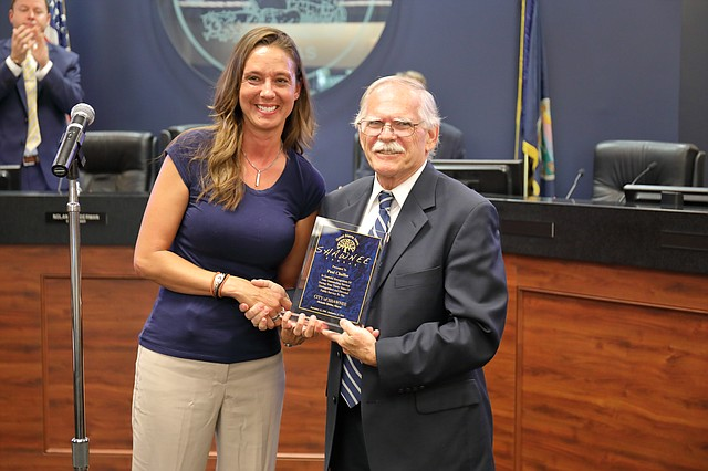 Shawnee mayor Michelle Distler honors retired planning director Paul Chaffee at the Sept. 10 city council meeting.