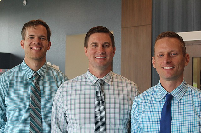 The Vision Care Associates doctors, from left to right: Connor Gallentine, Chris Arnold and Andrew Franken,