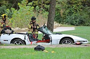 Firefighters removed both doors and the halo from the Targa top Corvette before the driver could be safely removed.