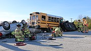 Firefighters arrived on the scene of the simulation to find a school bus involved in a crash with three other vehicles and multiple victims trapped.