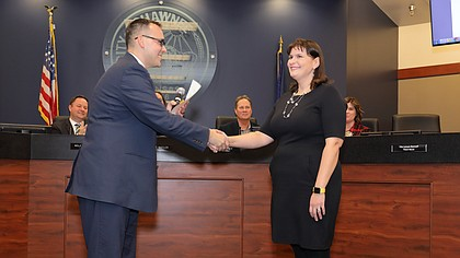 Lisa Larson-Bunnell is sworn in as the new Ward 3 Shawnee city council member by Deputy City Manager Stephen Powell at the council meeting on Tuesday evening.