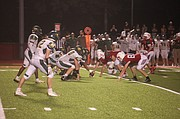 Tonganoxie High lines up against Basehor-Linwood on Friday at Beatty Field. The THS football team won its inaugural game on the new field turf with a 49-28 victory against the archrival Bobcats.