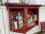 The book nook at the downtown pocket park at Fourth and Delaware streets in Tonganoxie has been converted into a makeshit satellite food pantry.
