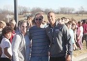 Longtime Tonganoxie educator Chris Weller stands with fellow Tonganoxie Middle School teachers Megan Carlton and Phil Jones outside TMS during a celebratory welcome back to campus for the TMS Battle of the Brains winners this past fall.