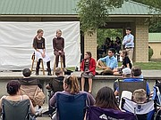 """Youths act out a scene during Tonganoxie Recreation Commission's summer youth theater production of """"The Lion, the Witch and the Wardrobe."""" Youths put on the play at Tonganoxie VFW Park this year due to the COVID-19 pandemic. The annual summer production normally takes place at the Tonganoxie Performing Arts Center on the Tonganoxie High School campus."""