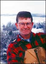 Weather has always been an interest of Charles Perry, and he doesn't use a groundhog to forecast it. He is pictured more than 40 feet above ground on the wind generator at his home northwest of Baldwin.