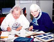 Library volunteers Katharine Kelly, left, and June Jewett research local history Friday afternoon. Baldwin City Public Library volunteers contributed more than 2,000 hours of their time last year.