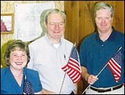 Krystal Williams, Carl Butell and Dave Hill are just a few of the people who plant American flags in the yards of Baldwin City on July 4. Their businesses also contribute to the project.