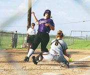 Baldwin High School's Kristen Wessel dodges an attempted tag at home plate during the Bulldog's doubleheader sweep at Louisburg.