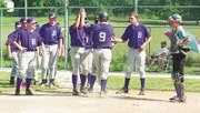 It was high fives all around for Jason Rose (No. 9) after he powered a home run to get the Baldwin Legion on the scoreboard during Sunday's game.