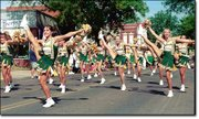 The Basehor-Linwood High School cheerleaders entertain the crowds during the Tiblow Days parade Saturday, Aug. 25, in Bonner Springs. The group was among dozens of entries that performed in the two-hour parade. The Basehor-Linwood High School band also performed during the parade.
