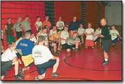 Bonner Springs High School wrestling coach Randy Lowe talks to his squad during a recent practice. The Braves open the season on Wednesday, Nov. 29 in a double dual at Basehor-Linwood.