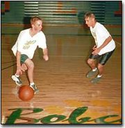 Basehor-Linwood junior guard Jake Hills, left, tries to dribble past teammate Nick Verbenec during a drill at a recent practice.