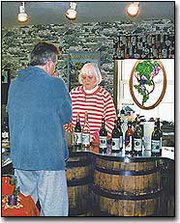 "A customer visits the winery gift shop. Holy-Field Vineyard and Winery has won numerous international awards and medals for winemaking. Part-owner Les Meyer said Kansas is not a hard place to produce grapes. ""Grapes are real versatile. The only place a grape won't grow is in a swamp,"" Les said."