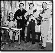 Harold Green, second from left, and his band pose for a photo in the television studio.