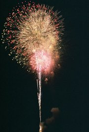 Fireworks light up the sky during the finale of De Soto's July Fourth show. Most spectators watched Monday's display from the track and stands behind Lexington Trails Middle School.