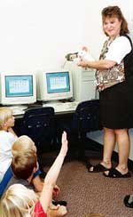 Suzanne Sherman instructs Starside students on proper computer skills with Clicker the mouse.