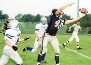 Senior tight end Travis Chavez stretches for a pass as the Jaguars fell short against Perry-Lecompton, 23-13, in a rain-postponed game.
