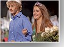 Colin O'Neill and Cheyenne Williams wear crowns as 2007 De Soto High School Homecoming king and queen soon after being crowned during the halftime of the school's football game Friday against Paola. The school started a new tradition an evening Thursday rally after a parade from downtown. The change worked as Wildcat teams had a very successful week.
