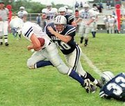 Mill Valley senior Travis Chavez tackles an opponent during a Jaguar game. Chavez was named to the All-Kaw Valley defensive team for his performance this season.