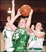 Ashley Carlson pulls down an offensive rebound last Friday.