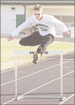 DeSoto junior Brad Buser clears a hurdle during a recent practice. The Wildcats, who finished third at their league meet last year, have the talent and depth to compete this year for a Kaw Valley League title and perhaps much more.